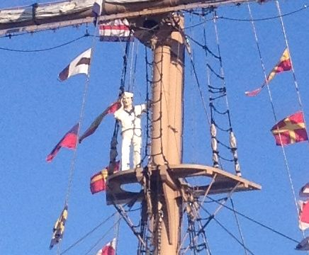 sailor on recreated mast of the whaling ship Manhattan