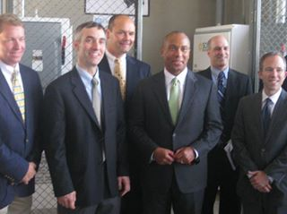 James Worden, CEO of SE, and Deval Patrick at ribbon cutting of a solar array