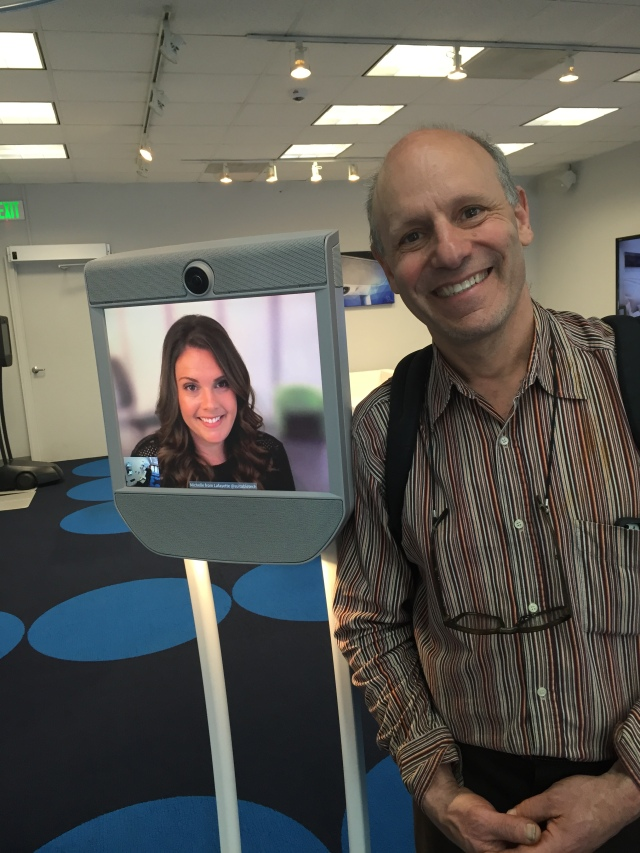 Ted Selker and a Beam agent on a telepresence robot