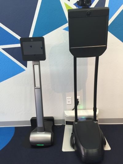 Consumer-level Beam+ on left, BeamPro on right.  Docking stations on floor